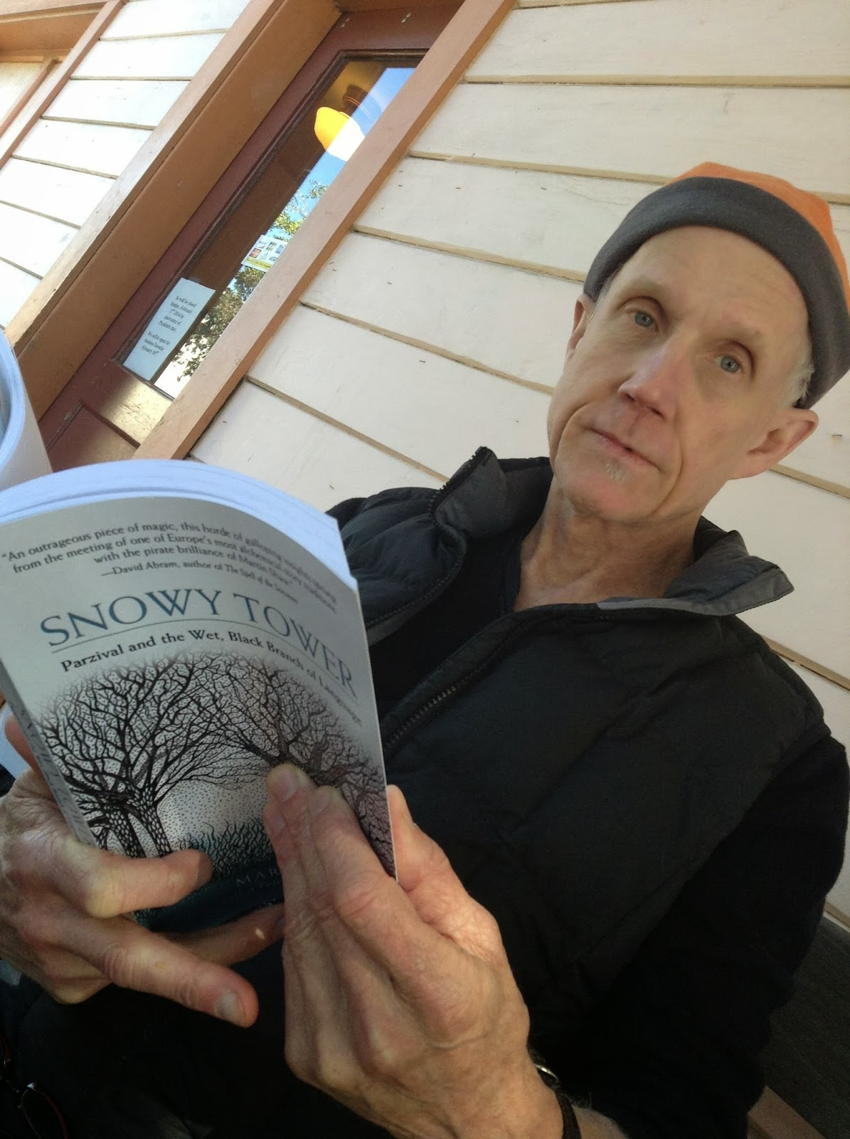 Tony Hoagland holding Martin Shaw's book Snowy Tower